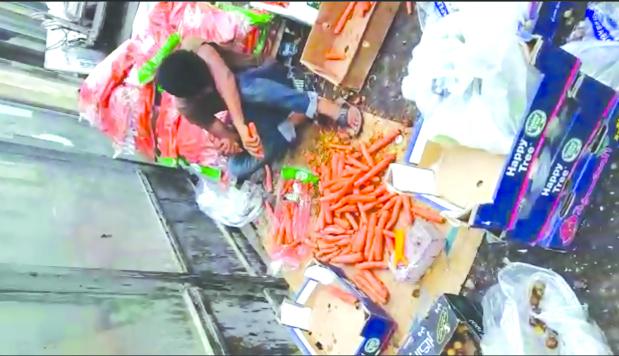Health warning after vendors caught retrieving dumped vegetables