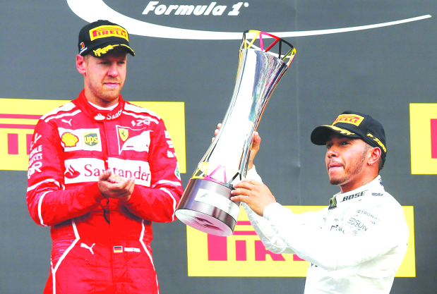 200TH RACE JOY: Hamilton wins Belgian GP to trim Vettel lead