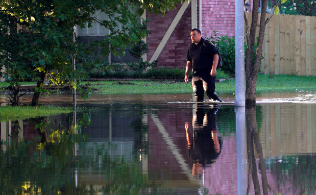 World News: As floodwaters recede, Houston officials look to recovery