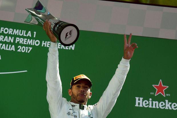 Hamilton tames rivals and hostile crowd in Monza