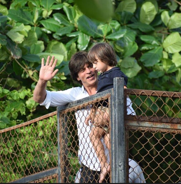Photos: Shah Rukh Khan and AbRam wave to fans on Eid