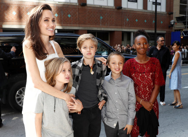GLOWING pictures of Angelina Jolie surrounded by her children at Toronto Film Festival