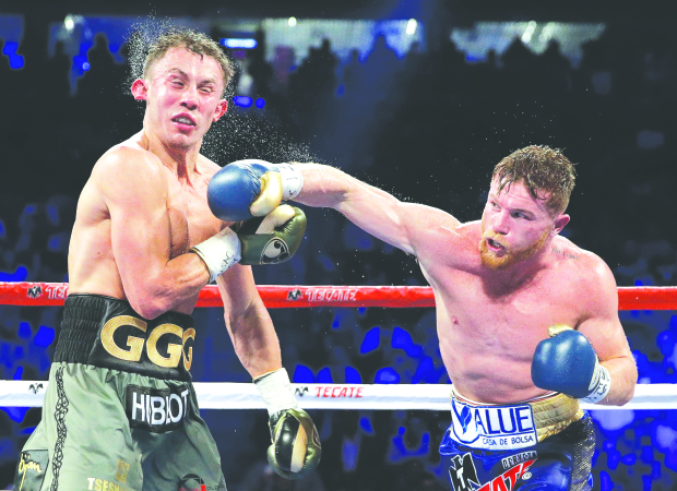 Golovkin retains titles after fight with Alvarez ends in draw