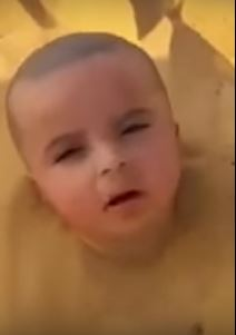 Video: Toddler buried up to his head in sand sparks outrage!