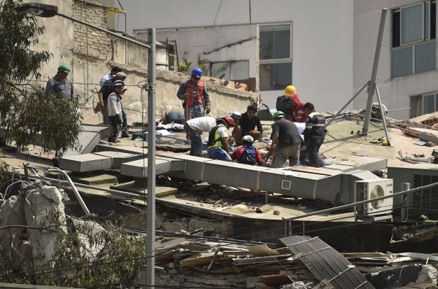 World News: In Pictures: 7.1 magnitude quake kills 217 in Mexico