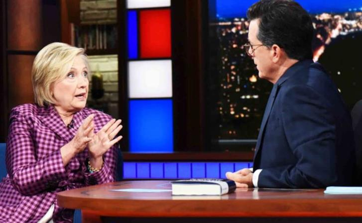 Clinton mocks 'manspreading' Putin on Stephen Colbert's show
