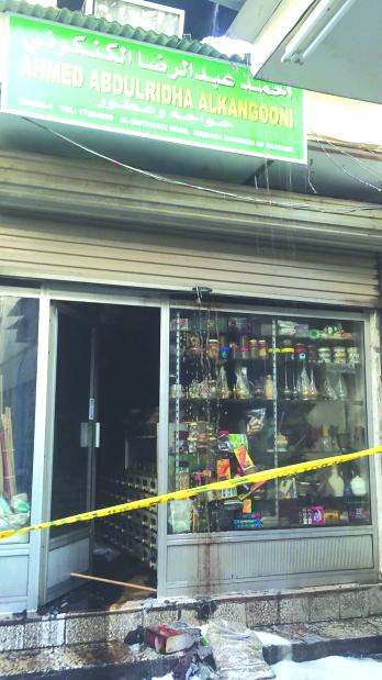 Firemen put out blaze in a store in Manama