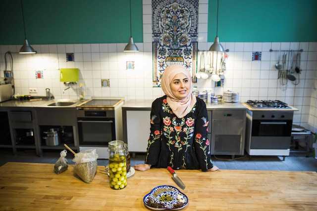 PHOTOS: From fleeing Syria to dazzling Merkel in the kitchen