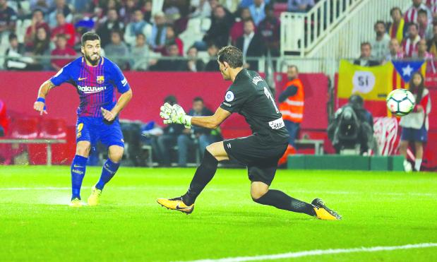 La Liga: Suarez shines as Barca sink Girona