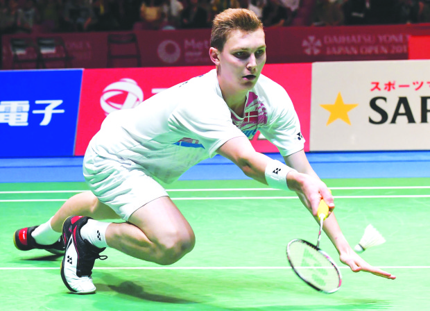 Axelsen sends Son crashing