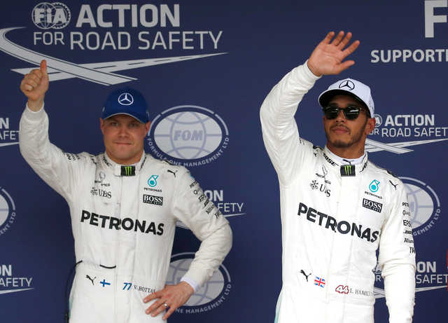 Dominant Hamilton seizes pole for Japanese Grand Prix