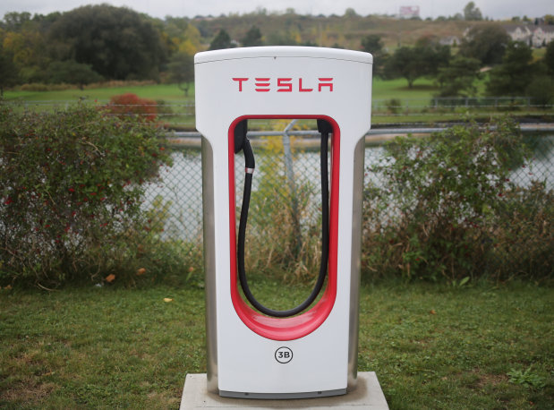 Tesla fires hundreds of workers as part of annual reviews