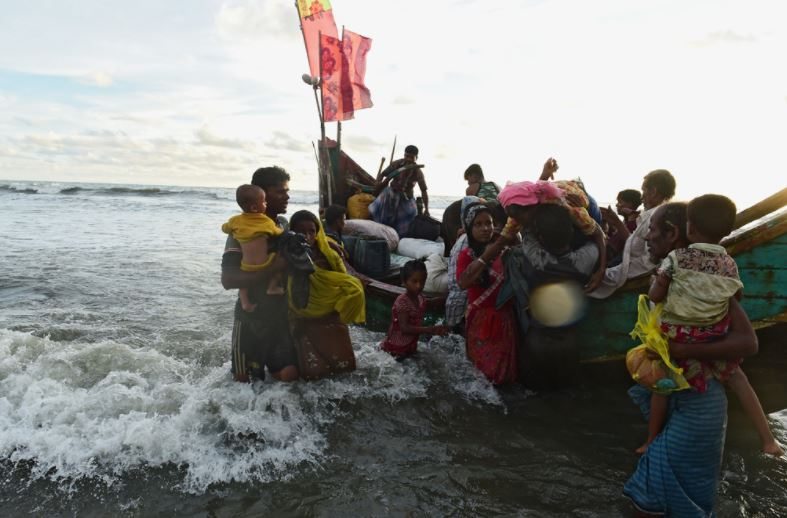 Boat carrying Rohingya Muslims capsizes, killing at least 12