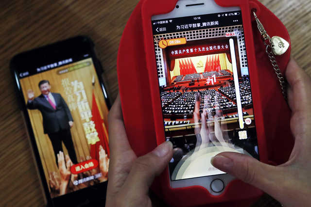 """Viral smartphone game lets ordinary Chinese """"clap"""" for Xi"""