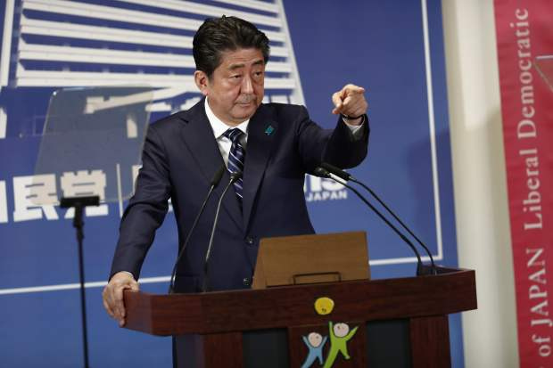 Analysts: Japan's Abe wins votes but not hearts