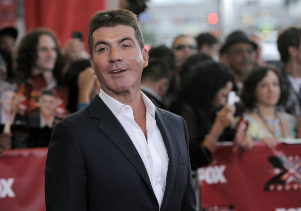 Simon Cowell back home from hospital after fall in London