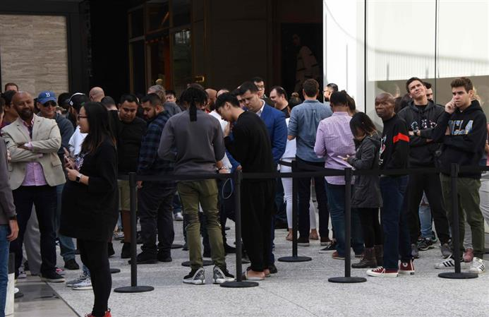 Long queues, protests as Apple's iPhone X hits stores