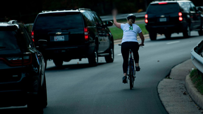 Cyclist who gave Trump the finger loses her job