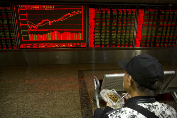 China blue chips scale two-year high, banking and energy firms lend support