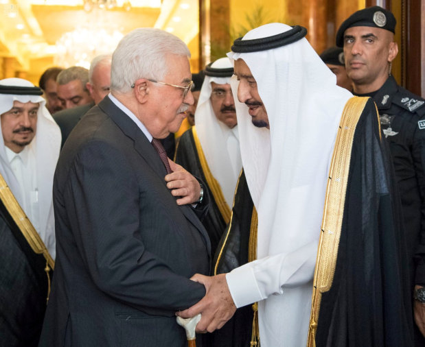 In Pictures: Saudi king hosts Abbas after Palestinian accord