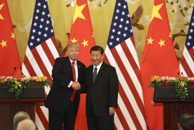 US, China sign $250 billion in business deals as Trump visits