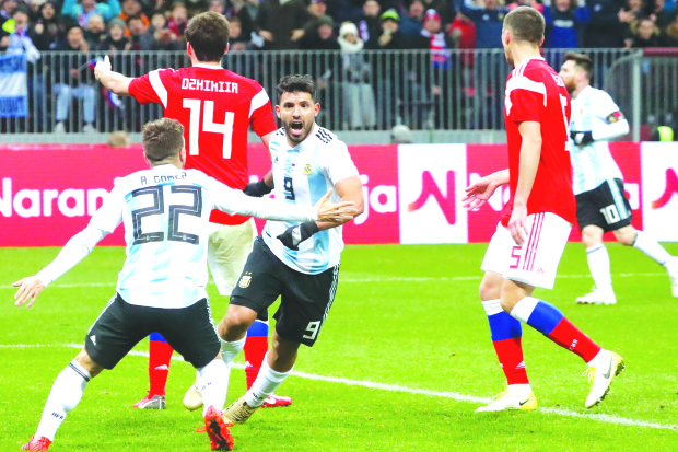 Aguero lifts Argentina past Russia