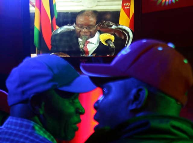 Zimbabwe's Mugabe defies expectations of immediate resignation