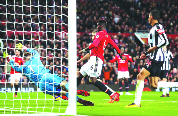 English Premier League: Pogba shines to seal United win