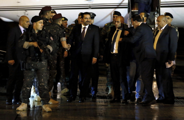 Hariri back in Beirut, attends Lebanon's military parade