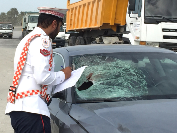 "An elderly Bahraini died when he was hit by a car as he crossed the road yesterday. Ghuloom Haji Ramad, 74, was struck by an Audi while crossing Shaikh Jaber Al Sabah Highway, near Sitra, at 10.30am. The Interior Ministry tweeted that ""relevant procedures were taken"". Above, an officer inspects the damaged windscreen of the car that hit Mr Ramad."
