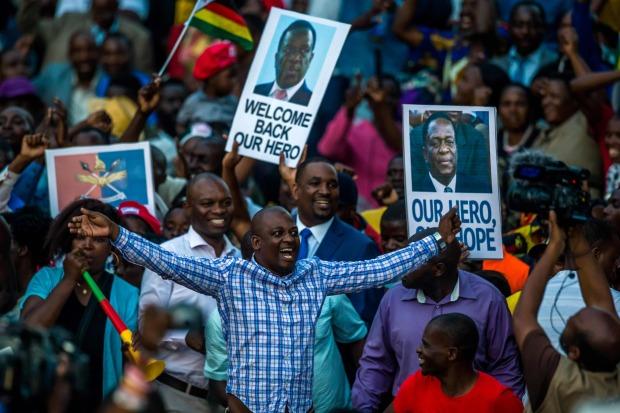 Zimbabwe's incoming leader returns home to cheers