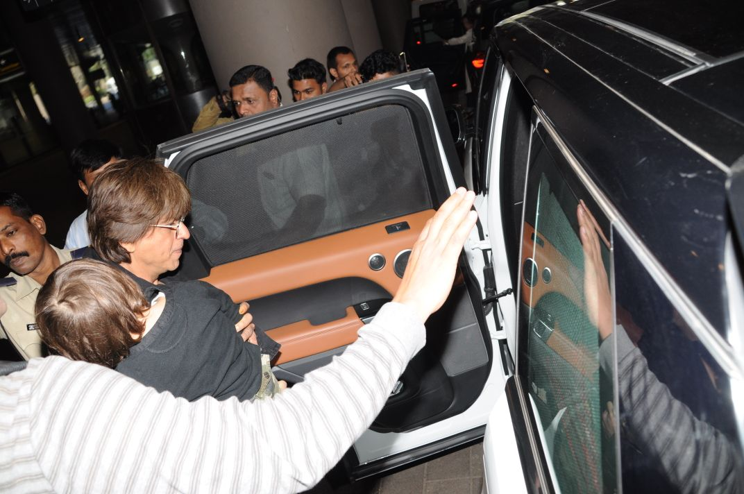 Bollywood: IN PICTURES: Shah Rukh Khan and son AbRam return home after holidaying in London
