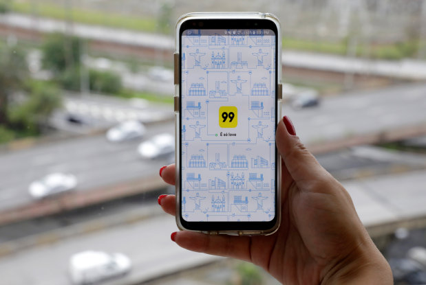 China ride-hailer Didi buys Brazil's 99 in new challenge to Uber