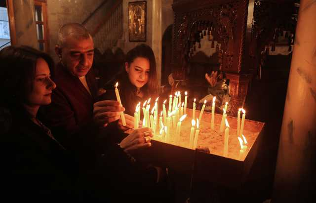 Palestinians mark Orthodox Christmas amid boycott calls