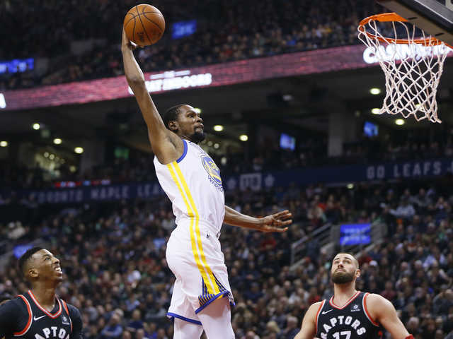 NBA: Warriors hold off charging Raptors to win on road