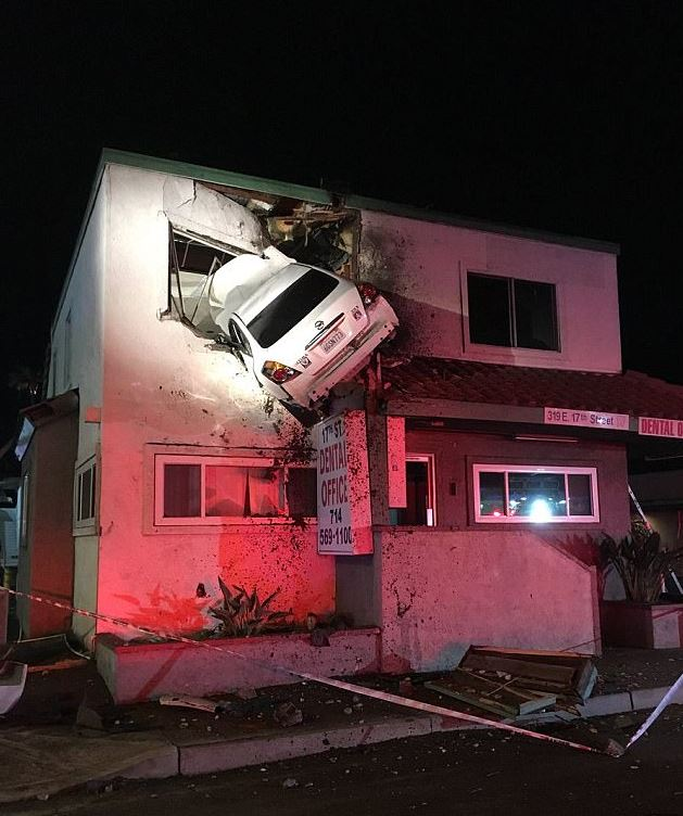 VIDEO: CCTV shows how car ended up being stuck on the upper floor of building!