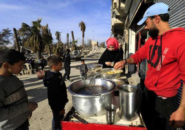 At beloved falafel shop, Syrians get taste of pre-war Raqa