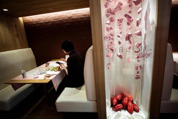 World News: Tickled pink: Japan lovers taste new chocolate on Valentine's Day