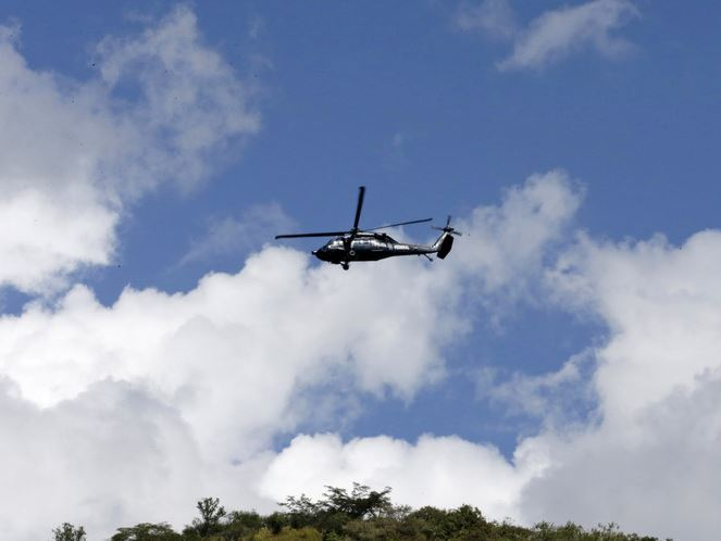 Mexico minister survives helicopter crash that killed two on ground