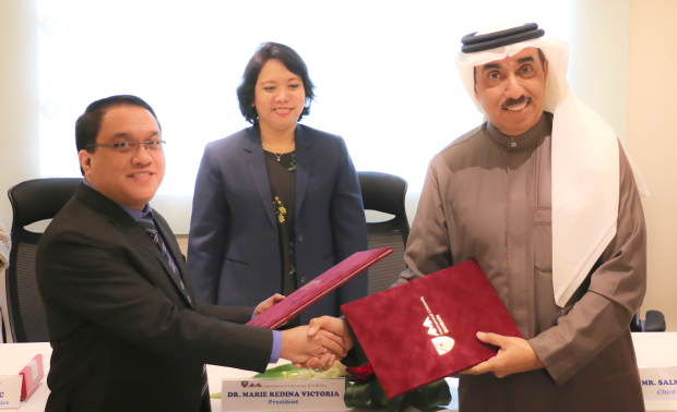 <p>AMA International University Bahrain students can now receive vocational and practical training from the Bahrain Airport Services (BAS) company. A memorandum of understanding was signed by BAS chief executive Salman Al Mahmeed and university academic affairs vice-president Dr Geraldo Talisic. The agreement provides a common framework to diversify opportunities by expanding research facilities, vocational and practical training and exchange of knowledge to benefit university students and BAS employees. Above, Dr Talisic, left, and Mr Al Mahmeed, right, sign the agreement in the presence of university president Dr Marie Redina Victoria.</p>