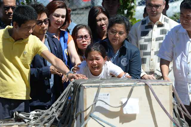 Call for justice as Filipina's body returns home from Kuwait