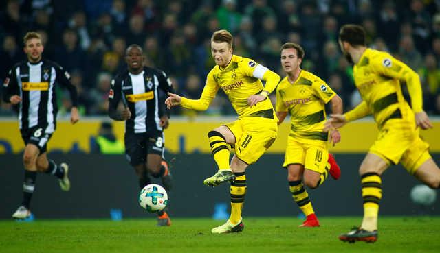Bundesliga: Pitch battle as Reus ends goal drought in Dortmund win
