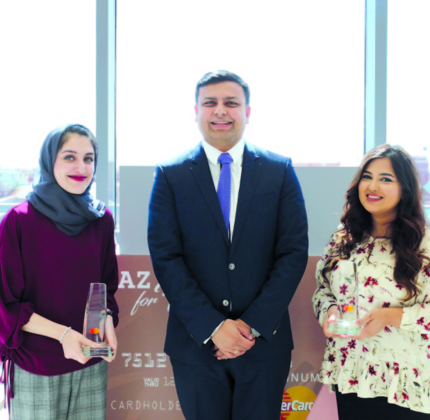 <p><em>Ms Al</em> <em>Saati</em>,<em> left, and Ms Bastaki receiving the award from Mr Raj.</em></p>