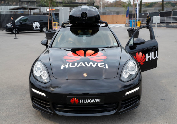 Tech Talk: PICTURES: Huawei's AI-powered smartphone drives a Porsche