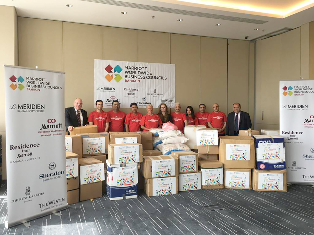 <p><em>Sheraton Hotel general manager Thomas Flindt, left, with Sheraton Hotel human resources director Othman Ahmed, right, in the presence of Marriott associates</em></p>