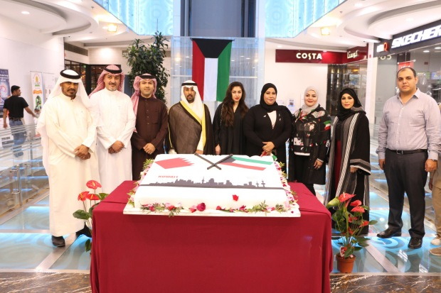 <p><em>At the cake-cutting ceremony are, from left, Mr Hassan Bokhowa, parliament financial and economic affairs committee vice-chairman Jalal Kadhem, Mr Riyadh Bokhowa, Mr Alroumi and Ms Bokhowa, second from right, with guests</em></p><p>A special celebration was held at Saar Mall to mark Kuwait National Day. </p><div>It featured a bazaar showcasing Kuwaiti and Bahraini products, competitions and raffles.</div><div><br></div><div>The celebration was organised by the Human Dream organisation and attended by Kuwait Embassy official Yousif Alroumi, Saar Mall board chairman Hassan Bokhowa and managing director Esmahan Bokhowa, Bokhowa Group managing director Riyadh Bokhowa and Bahraini bloggers. </div>
