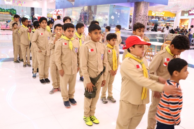 <p><em>Children in Boy Scout outfits taking part in the celebrations</em></p>
