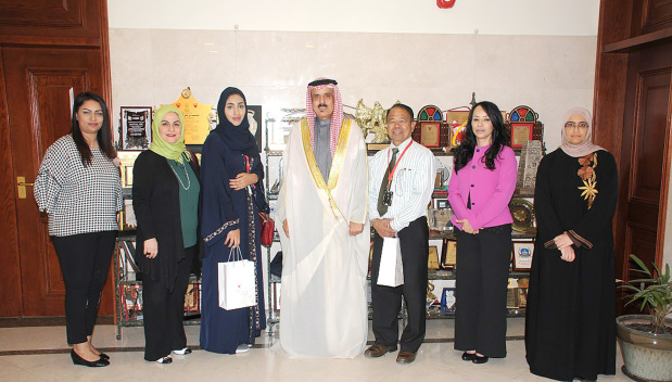 <p>A mechanical engineering apprentice was honoured for achieving high results. Education Minister Dr Majid Al Nuaimi received Ebtihal Jassim at the ministry's office in Isa Town and praised her excellence at welding as the first trainee in this specialised field from the Bahrain Training Institute (BTI) over the past few years. Present were BTI acting director general Dr Samah Al Ajawi and other ministry officials. Above, Dr Al Nuaimi with Ms Jassim, third from left, Dr Al Ajawi, second from left, and other officials.</p>