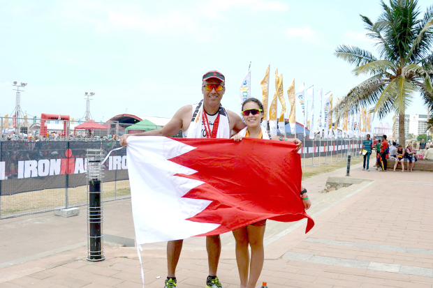A Bahraini father and his daughter completed the Ironman 70.3 competition in Colombo, Sri Lanka despite difficult conditions. The event included a 1.9km ocean swim, followed by a 90km fast-paced bike ride and ended with a 21.1km run through some of Colombo's landmarks. Yousif Al Thawadi, aged 55, finished fourth out of 23 participants in his category despite sustaining an injury during the run, while 27-year-old Sarah finished fifth in her category and overall 27th out of 118 participants. Both are members of the Bahrain Road Runners. Above, Mr Al Thawadi and Sarah hold up a Bahraini flag after completing the race.