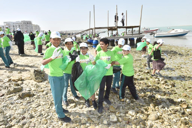 <p>The Gulf Petrochemical Industries Company (GPIC) organised a beach clean-up campaign next to Qal'at Al Bahrain, also known as Bahrain Fort, located in Karbabad. More than 300 students from both public and private schools took part in the campaign, which is being held for the fourth consecutive year. Gloves, plastic bags, sunscreen caps, refreshment and snacks were all provided to the volunteers by the company. Above, students along with officials after the clean-up. </p>